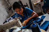 A Salvadoran seamstress sews an indigo-dyed dress on the sewing machine in an artisanal clothing workshop in Santiago Nonualco, El Salvador, 6 April 2018. For centuries, indigo, a natural deep blue dye extracted from the leaves of tropical plants, has been known to the native indigenous inhabitants of Central America. Nowadays, a growing demand for handmade, nature-based products has has permitted the emergence of various clothing workshops and cooperatives. Employing traditional design techniques and inspired by the ancient Mayan artists, they produce fashion collections, clothing accessories or decorative items on a sustainable, small scale basis.