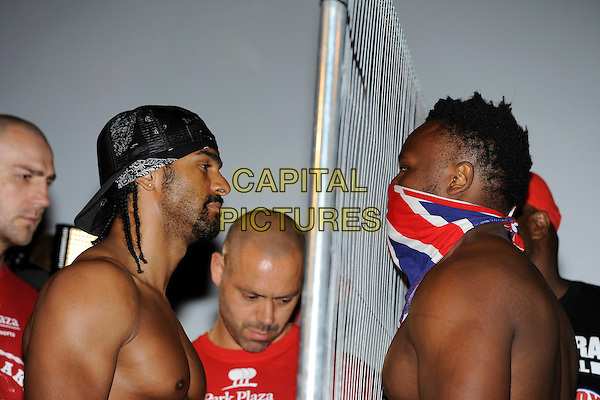 David Haye and Dereck Chisora .David Haye and Dereck Chisora Weigh-In at The Odeon Leicester Square, London, England. .July 12th, 2012.headshot portrait fence side profile chest topless bandana goatee facial hair  .CAP/IA.©Ian Allis/Capital Pictures.