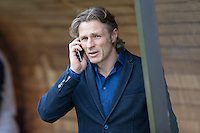 Wycombe Wanderers manager Gareth Ainsworth takes a call ahead of the Sky Bet League 2 match between Plymouth Argyle and Wycombe Wanderers at Home Park, Plymouth, England on 30 January 2016. Photo by Mark  Hawkins / PRiME Media Images.