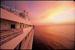 Boutique cruise ship at sunset in the Caribbean.