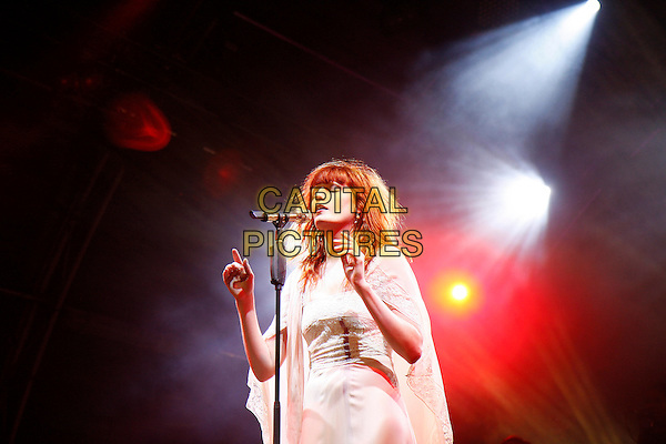 FLORENCE WELCH.Florence and The Machine perform live at Somerset House, London, England..July 15th, 2010.stage concert live gig performance music half length white dress singing arms hands sheer.CAP/MAR.© Martin Harris/Capital Pictures.