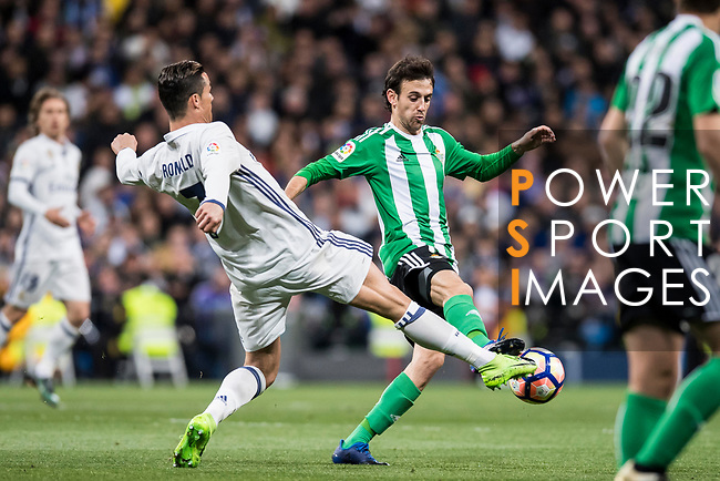 Cristiano Ronaldo (l) of Real Madrid fights for the ball with Ruben Pardo Gutierrez of Real Betis during their La Liga match between Real Madrid and Real Betis at the Santiago Bernabeu Stadium on 12 March 2017 in Madrid, Spain. Photo by Diego Gonzalez Souto / Power Sport Images