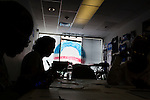 Alice W. Harris, left, and Anahita Knonsari, second from left, volunteers with Organizing for America, President Obama's re-election campaign arm, make phone calls to potential supporters in the group's Richmond headquarters on Thursday, May 3, 2012 in Richmond, VA.