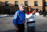 Sunday resident Ross Lehmkuhler (cq) poses for a selfie with Olympic Gold champion wrestler Jordan Burroughs (cq) in Sidney, Nebraska, Sunday, February 14, 2015. Burroughs has become a celebrity in the wrestling world due to his success on the mat.<br /> <br /> Photo by Matt Nager