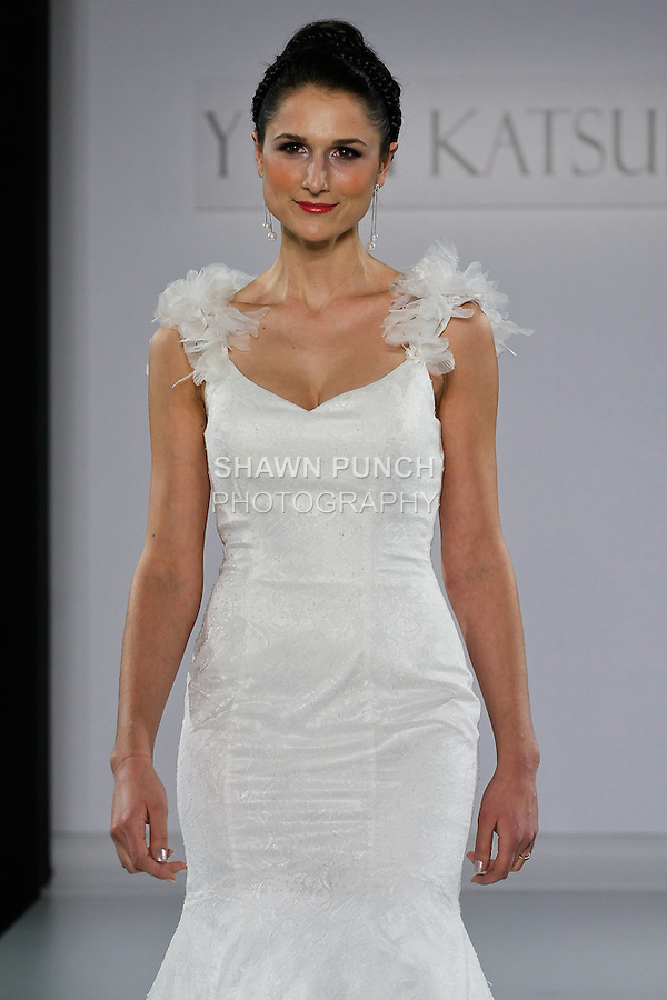 "Model walks runway in an Alexandria wedding dress from the Yumi Katsura Fall 2013 ""Painting The World With Beauty"" bridal collection, during The Couture Show New York Bridal Fashion Week, October 14, 2012."