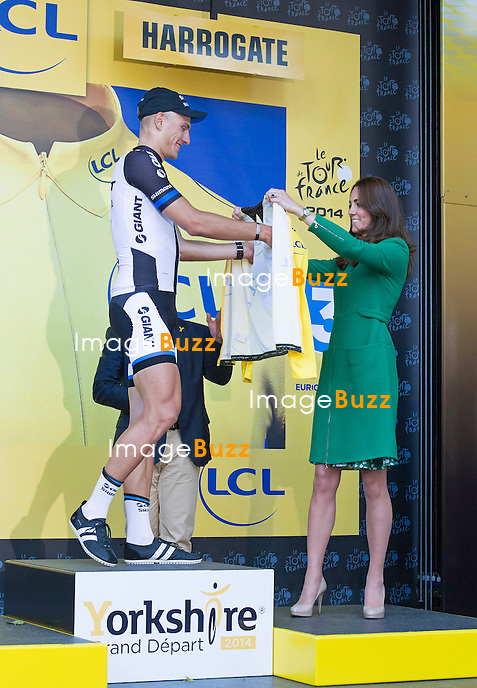 CATHERINE,  DUCHESS OF CAMBRIDGE, PRINCES WILLIAM AND HARRY<br /> presented Jerseys to the winning riders at the finish of Stage 1 of the 101st Tour de France, Harrogate, Leeds_05/07/2014<br /> Pictured: Kate presenting the Yellow Jersey to German Rider Marcel Kittel