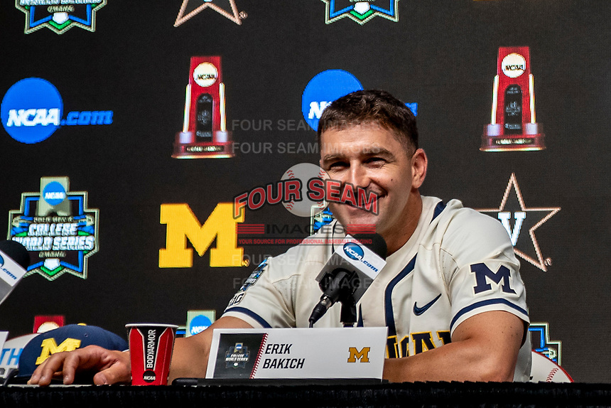 Michigan Wolverines head coach Erik Bakich smiles during the NCAA College World Series Finals press conference on June 23, 2019 at TD Ameritrade Park in Omaha, Nebraska. Michigan will play Vanderbilt in the CWS Finals. (Andrew Woolley/Four Seam Images)