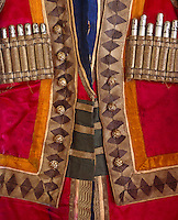 "A detail of a vividly coloured red and orange Cossack tunic designed for the Ballet ""Thamar"" in 1912"