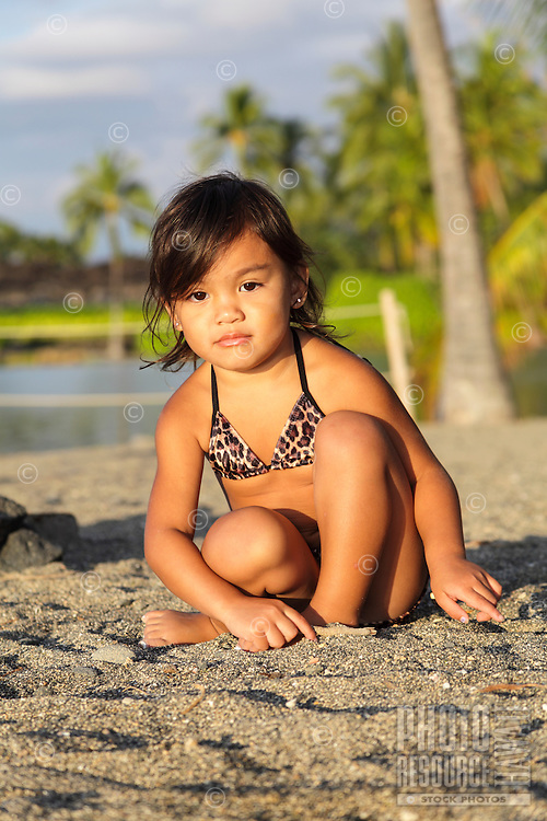 A young local girl plays in the sand at 'Anaeho'omalu Beach in Waikoloa, Hawai'i Island.