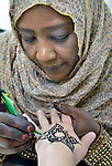 A refugee women in Cairo, Egypt, teaches a class in using henna to decorate women's bodies. The class is provided by St. Andrew's Refugee Services, which is supported by Church World Service.