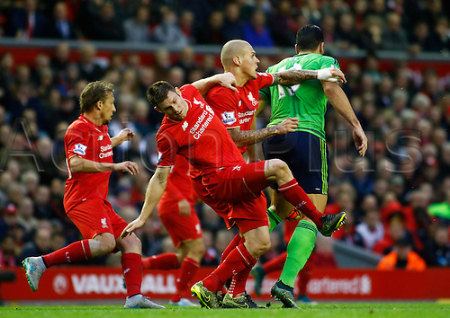 25.10.2015. Anfield, Liverpool, England. Barclays Premier League. Liverpool versus Southampton. Lucas, Milner and Skrtel close down Southampton striker Graziano Pellè.