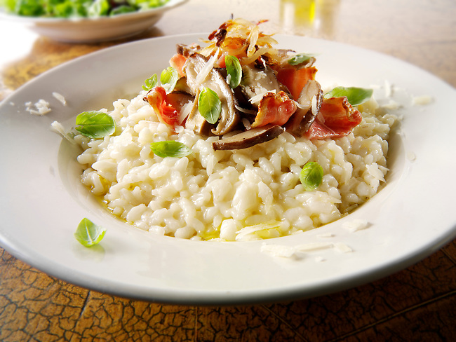 Classic risotto with wild porcini mushrooms and bacon