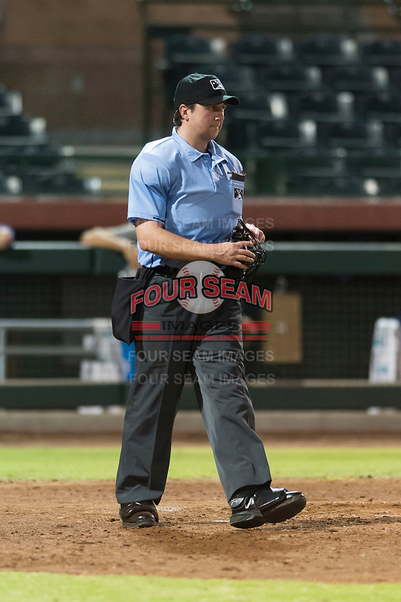 Home plate umpire Ethan Gorsak during an Arizona League game between the AZL Rangers and the AZL Giants Black at Scottsdale Stadium on August 4, 2018 in Scottsdale, Arizona. The AZL Giants Black defeated the AZL Rangers by a score of 6-3 in the second game of a doubleheader. (Zachary Lucy/Four Seam Images)