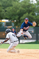 Ivan Marin of the Gulf Coast League Braves turns a double play as Juaner Aguasvivas of the Gulf Coast League Tigers tries to break it up the play. In the game against the Gulf Coast League Tigers July 3 2010 at the Disney Wide World of Sports in Orlando, Florida.  Photo By Scott Jontes/Four Seam Images