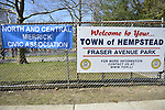 North Merrick, New York, USA. March 31, 2018. Banner for Sign for North and Central Merrick Civic Association (NCMCA) is next to the permanent Welcome to Your Town of Hemptead Fraser Avenue Park sign during  the Annual Eggstravaganza.