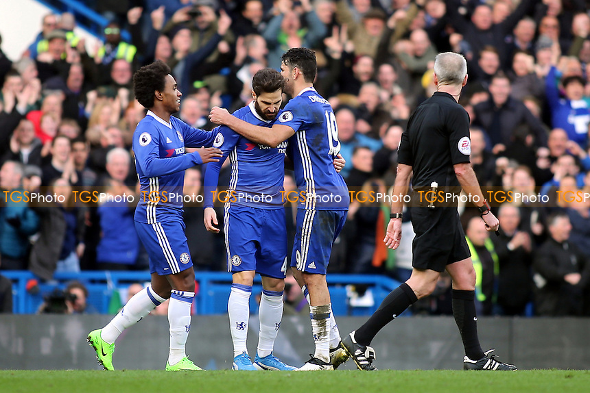 Willian and Diego Costa congratulate Cecs Fabregas after scoring Chelsea's third goal during Chelsea vs Arsenal, Premier League Football at Stamford Bridge on 4th February 2017