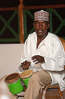 Zanzibar, Tanzania.  Member of Twinking Star Taarab Musical Group, a part of the Nadi Akhwan Safaa, Playing the Drums.