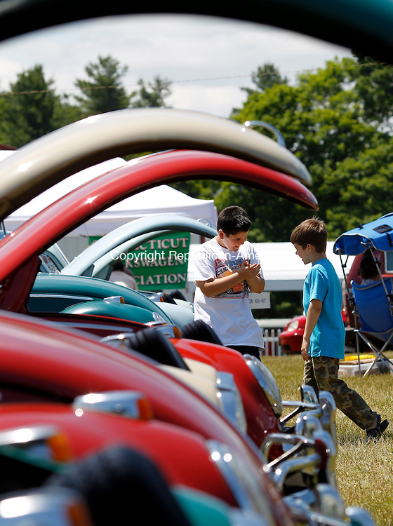 Harwinton, CT-17 June 2012-061712CM01-  Josh Gregory, 9 (left) and friend Josh Budnik, 9, both from Southington, dance to the tunes of the 23rd Annual Litchfield Bug-In Volkswagen Car Show Sunday afternoon at the Harwinton Fair Grounds.  The show is the major fundraiser for the Bronc Callahan Community Fund with all proceeds going to the Community Fund.  The event featured food, refreshments vendors and awards.   Christopher Massa Republican-American