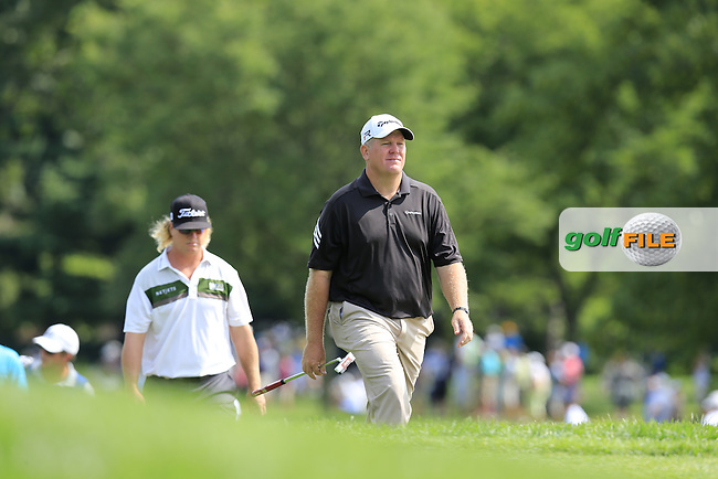 Bob Sowards and Charley Hoffman (USA) walk onto the 6th green during Thursday's Round 1 of the 95th US PGA Championship 2013 held at Oak Hills Country Club, Rochester, New York.<br /> 8th August 2013.<br /> Picture: Eoin Clarke www.golffile.ie