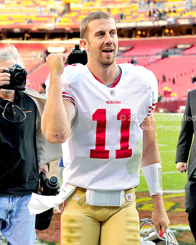 San Francisco 49ers quarterback Alex Smith (11) celebrates as he leaves the field following his team's 19 - 11 victory over the Washington Redskins at FedEx Field in Landover, Maryland on Sunday, November 6, 2011..Credit: Ron Sachs / CNP