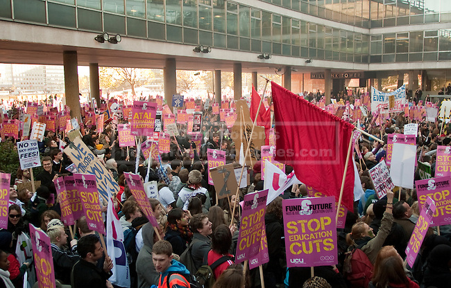 Demonstrators cram into the courtyard outside Conservative Party headquarters at 30 Millbank.  The protesters at Millbank were a minority of the roughly 50,000 people who took part in the first day of demonstrations against proposed government cuts to the educational system. 10/11/10