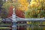 Fall foliage surrounds the Victorian bridge in the Boston Public Garden in Boston, MA, USA