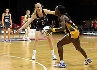 26.07.2015 Silver Ferns Laura Langman and South Africa's Bongiwe Msomi in action during the Silver Fern v South Africa netball test match played at Claudelands Arena in Hamilton. Mandatory Photo Credit ©Michael Bradley.