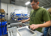 NWA Democrat-Gazette/BEN GOFF @NWABENGOFF<br /> Martin Salazar puts a new Walther PPK pistol into a machine that cycles the action Friday, Jan. 4, 2019, at Walther Arms in Fort Smith.