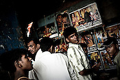 Local residents gather outside a video hall showing Bollywood movies in the slums of Dharavi, in Mumbai, India.