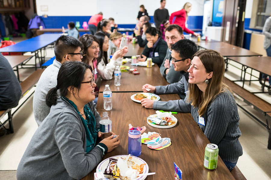 Parents and families get acquainted during a lunar new year event hosted by Families Through Korean Adoption (FTKA) in the gym and school cafeteria of St. Dennis Church in Madison, Wis., on Feb. 10, 2018. The event celebrated the passing of the lunar new year, and is one of several events for FTKA-member families and children to gather and enjoy cultural fun, food and play. (Photo by Jeff Miller - www.jeffmillerphotography.com)