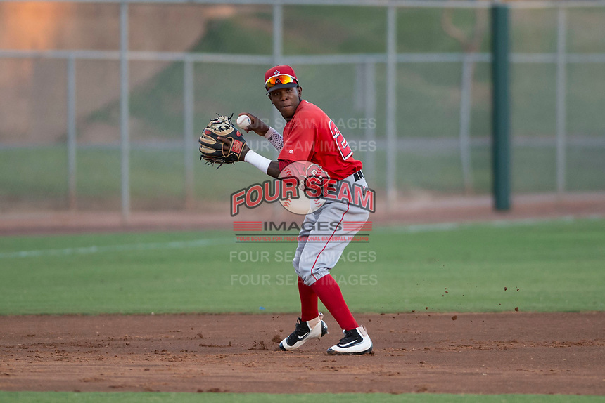 AZL Angels third baseman Daniel Ozoria (23) prepares to make a throw to first base during an Arizona League game against the AZL Giants Black at the San Francisco Giants Training Complex on July 1, 2018 in Scottsdale, Arizona. The AZL Giants Black defeated the AZL Angels by a score of 4-2. (Zachary Lucy/Four Seam Images)