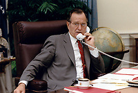 ***FILE PHOTO*** George H.W. Bush Has Passed Away<br /> United States President George H.W. Bush speaks by telephone to President Mikhail Gorbachev of the Soviet Union following his call to Chancellor Helmut Kohl of Germany from the White House in Washington, DC on July 17, 1990CAP/MPI/RS<br /> &copy;RS/MPI/Capital Pictures