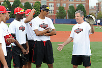 Under Armour All-American selections Nick Gordon of Olympia High School in Orlando, Florida (red hat) and Jacob Gatewood (black hat) of Redwood High School in Visalia, California listen to instructor Larry Bowa during a drill at the University of Illinois at Chicago on August 22, 2013 in Chicago, Illinois in preparation for the Under Armour All-American Game that will take place at Wrigley Field on August 24th.  (Mike Janes/Four Seam Images)