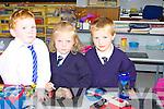 TOYS: Junior infants Fergal Sean O Cearra, Aoife Brid Ni? She agus Sea?mus Mac Gearailt have fun playing with toys during their first week of school at Scoil Naomh Eirc, Feothanach.