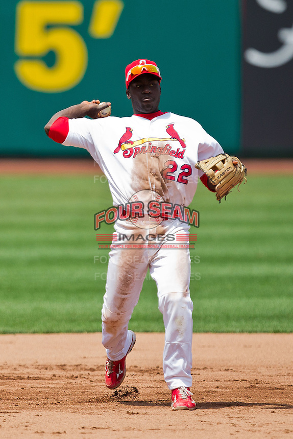 Jermaine Curtis (22) of the Springfield Cardinals throws to first base during a game against the Arkansas Travelers at Hammons Field on May 8, 2012 in Springfield, Missouri. (David Welker/ Four Seam Images)