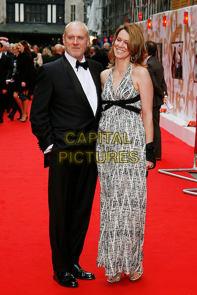 ALAN DALE & TRACEY PEARSON.Red Carpet Arrivals for the British Academy Television Awards 2008, held at the London Palladium, London, England, April 20th 2008..BAFTA BAFTA's full length black suit bow tie white print patterned dress maxi Tracy .CAP/DAR.©Darwin/Capital Pictures