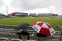 Spectators shelter under umbrellas as rain delays play during Lancashire CCC vs Essex CCC, Specsavers County Championship Division 1 Cricket at Emirates Old Trafford on 6th September 2017
