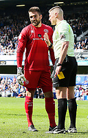 Referee Robert Jones speaks to Queens Park Rangers' goalkeeper Matt Ingram before showing him a yellow card<br /> <br /> Photographer Andrew Kearns/CameraSport<br /> <br /> The EFL Sky Bet Championship - Queens Park Rangers v Preston North End - Loftus Road - London<br /> <br /> World Copyright &copy; 2018 CameraSport. All rights reserved. 43 Linden Ave. Countesthorpe. Leicester. England. LE8 5PG - Tel: +44 (0) 116 277 4147 - admin@camerasport.com - www.camerasport.com