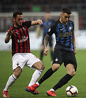 Calcio, Serie A: AC Milan - Inter Milan, Giuseppe Meazza (San Siro) stadium, Milan on 17 March 2019.  <br /> Inter's Matias Vecino (l) in action with Milan's Andrea Bertolacci (r) during the Italian Serie A football match between Milan and Inter Milan at Giuseppe Meazza stadium, on 17 March 2019. <br /> UPDATE IMAGES PRESS/Isabella Bonotto