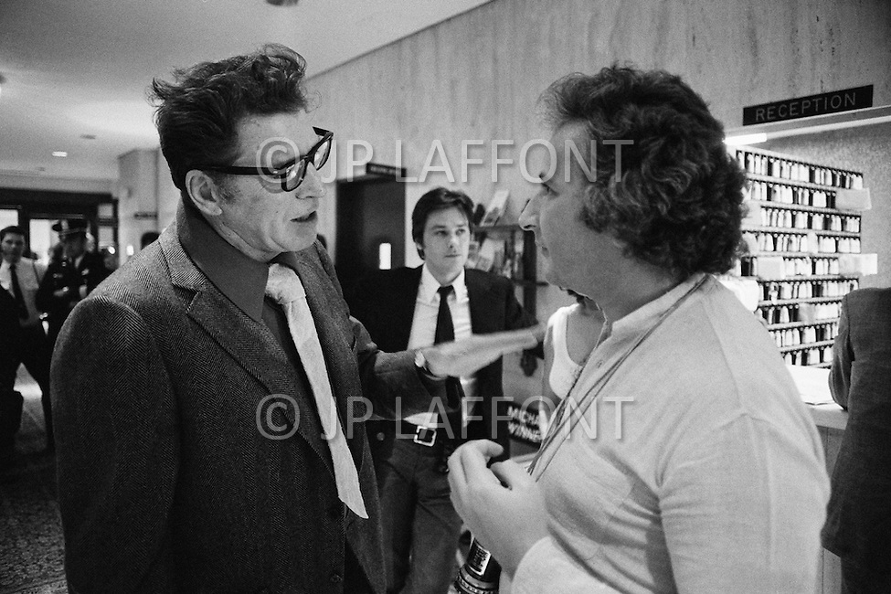 Washington DC, USA. June 4th, 1972.American actor Burt Lancaster talking with the English director Michael Winner, with French actor Alain Delon in the background, during the filming of Scorpio, set in the Washington D.C. Watergate Building.