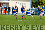 Renards Killian Young runs into a wall of Cordal players, Philip O'Connor, Johnny O'Connor and John Brosnan in the Junior Club Football Championship semi final in Beaufort on Sunday.