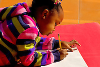 A young girl takes time out to draw during the Wells Fargo Community Celebration, held October 29, 2011 in downtown Charlotte NC. The daylong festival took place in the streets, in public atriums and in downtown museums, which offered free admission all day long. Wells Fargo, which this month completed its conversion from Wachovia, picked up the bill.