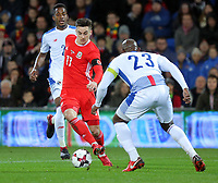 Tom Lawrence of Wales runs past Felipe Baloy of Panama (R) during the international friendly soccer match between Wales and Panama at Cardiff City Stadium, Cardiff, Wales, UK. Tuesday 14 November 2017.