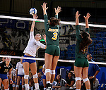 BROOKINGS, SD - SEPTEMBER 30:  Kacey Herrmann #3 from South Dakota State tries to get a kill past Emily Minnick #3 and Monica Claxton #9 from North Dakota State in the fourth game of their match Tuesday night at Frost Arena in Brookings. (Photo/Dave Eggen/Inertia)