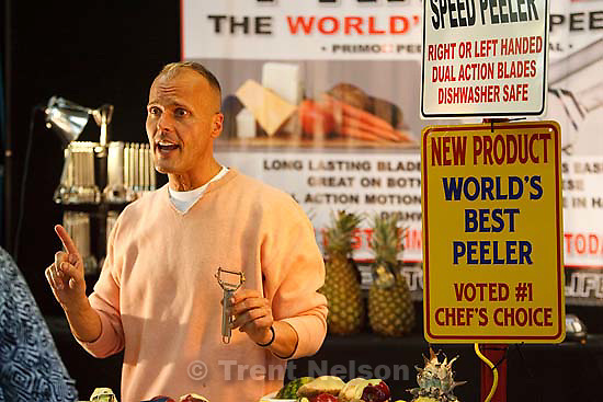 """Pitchman Max Cheigh, demoing a product billed as """"the World's Best Peeler"""" at the Utah State Fair Thursday, September 17 2009 in Salt Lake City. Cheigh, who hails from San Diego, has been work in pitch sales for four years and says that Utah's fair crowds typically come out at night. While fairs elsewhere close at 9pm, he says he finds himself working until 11pm in Utah."""