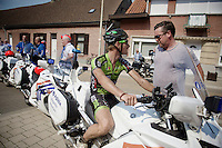 Gorik Gardeyn (BEL/Veranclassic) jumps on 1 of the blocking police moto's at the 2nd neutralisation and gets info from course designer (former pro rider) Niko Mattan.<br /> <br /> 90th Schaal Sels 2015