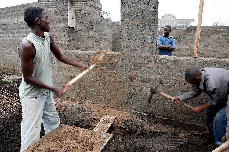 Workmen building a new health centre in Arusha.