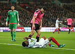 Robert Snodgrass of Scotland talks to Danny Rose of England after he went down in the penalty area during the FIFA World Cup Qualifying Group F match at Wembley Stadium, London. Picture date: November 11th, 2016. Pic David Klein/Sportimage