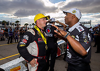 Oct 30, 2016; Las Vegas, NV, USA; NHRA top fuel driver Steve Torrence (left) talks with Antron Brown as he celebrates after winning the Toyota Nationals at The Strip at Las Vegas Motor Speedway. Mandatory Credit: Mark J. Rebilas-USA TODAY Sports