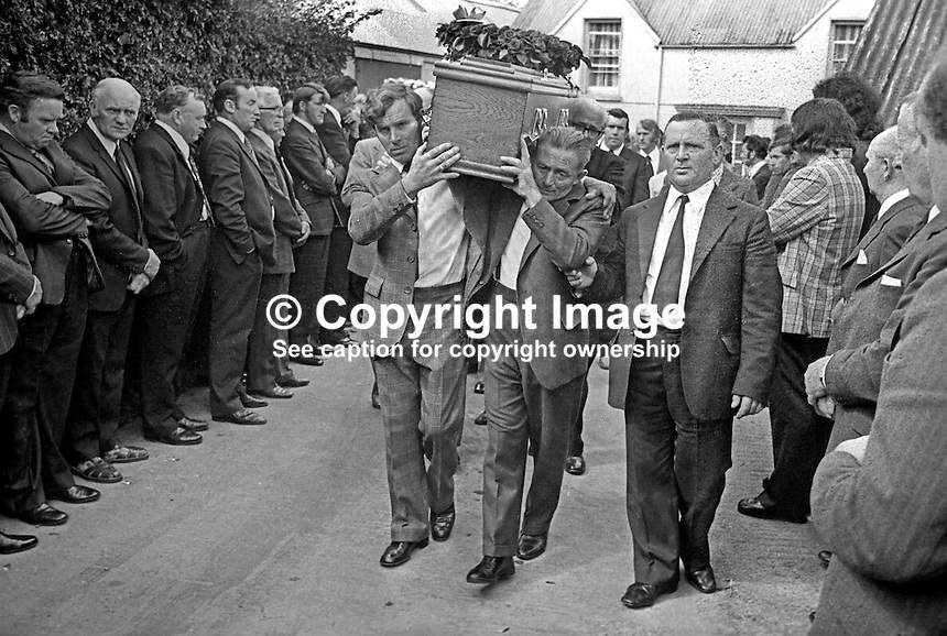 Funeral cortege of Brian McCoy, trumpeter, one of three members of the Miami Show Band, who died in a UVF attack as the band was travelling back to Dublin after appearing in Banbridge, leaves from his family home in Caledon, Co Tyrone, N Ireland, 2nd August 1975. 197508020595a<br />